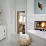 60 master bathrooms with a fireplace photos