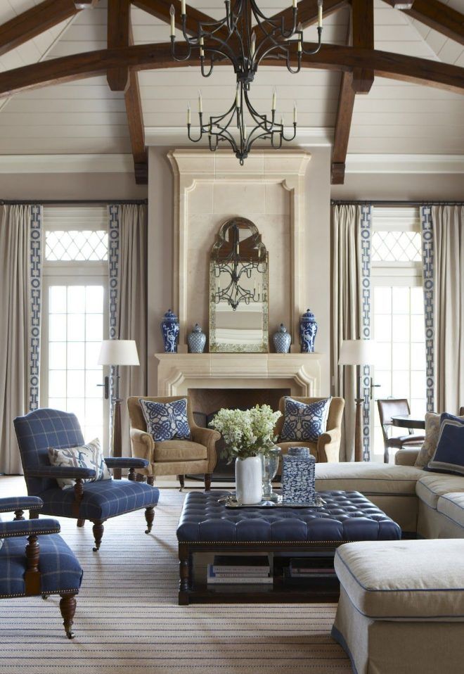 a beautifully done living room in navy with blue and white