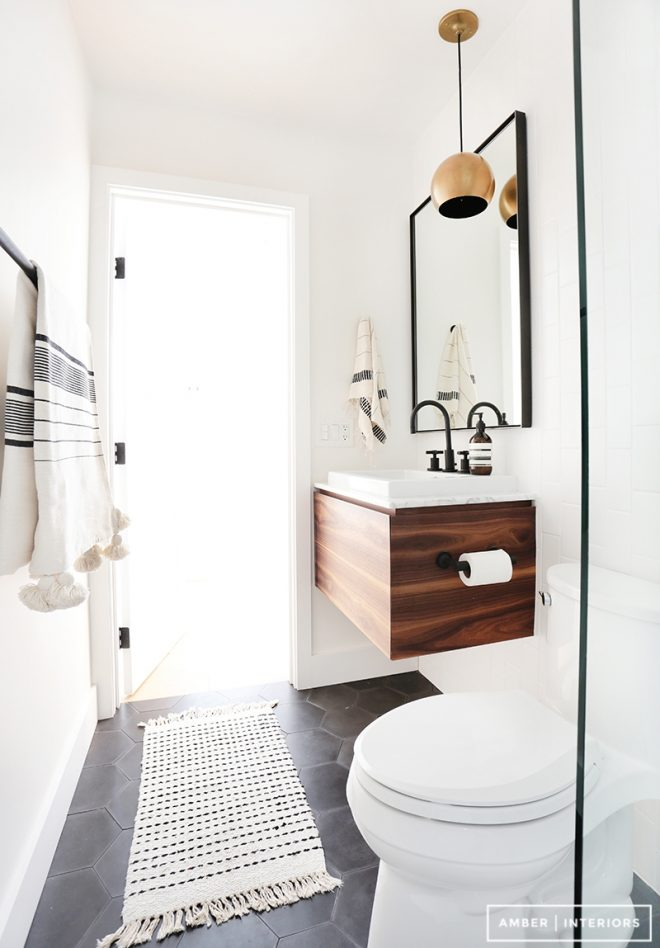 a black and white minimalist wood bathroom amber
