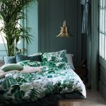 a charming tropical vibe on this beautiful master bedroom