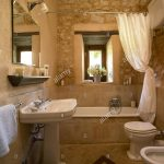 a country bathroom with exposed rustic stone walls bath