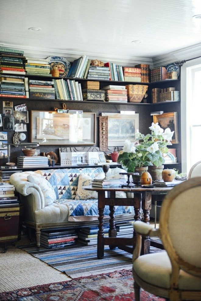 a cozy library family room with dark panelled walls full of