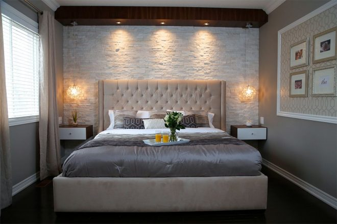 a crisp and clean master bedroom accented with white stone