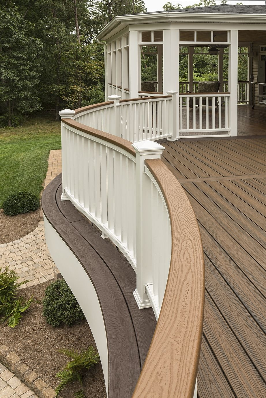 a curved railing from trex adds style and flair to your deck
