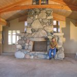 a huge river rock fireplace built tom and morgan river