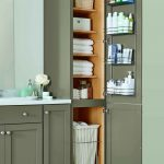 a linen closet with four adjustable shelves a chrome door rack and