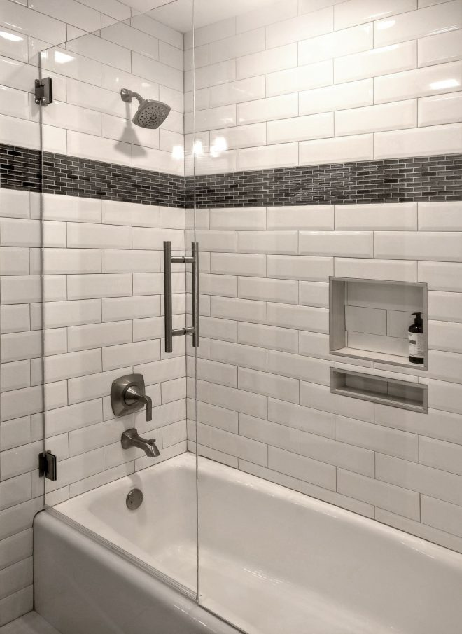 a stunning tub surround with white beveled subway tile chic