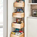 a tall pantry with deep drawers makes achieving a well
