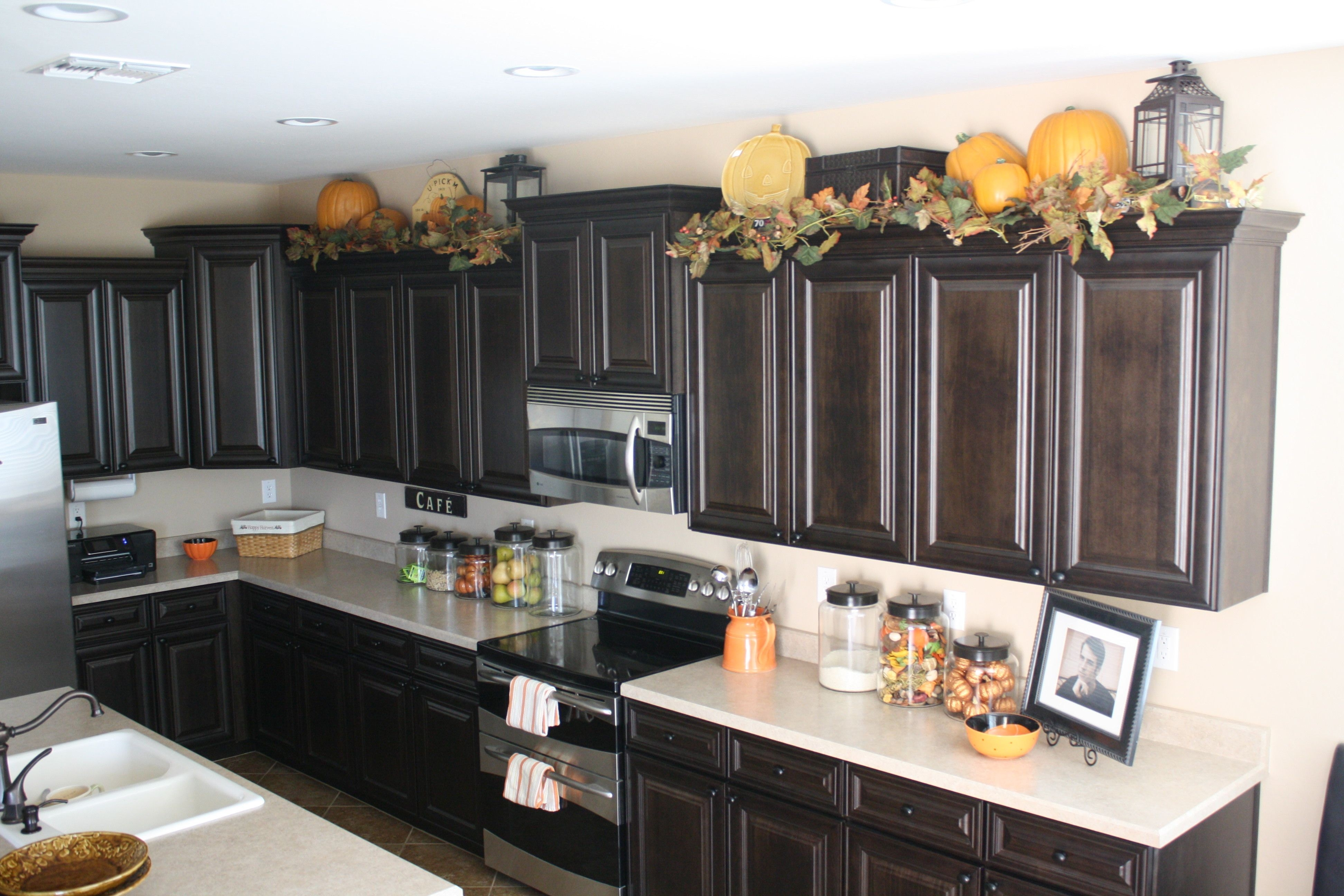 Above Kitchen Cabinet Decor Sightly Lanterns On Top Of Opnodes