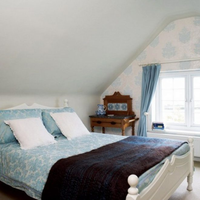 alluring attic bedroom design featuring white wooden bed frames and