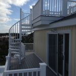 aluminum powder coated spiral stair from a rooftop deck