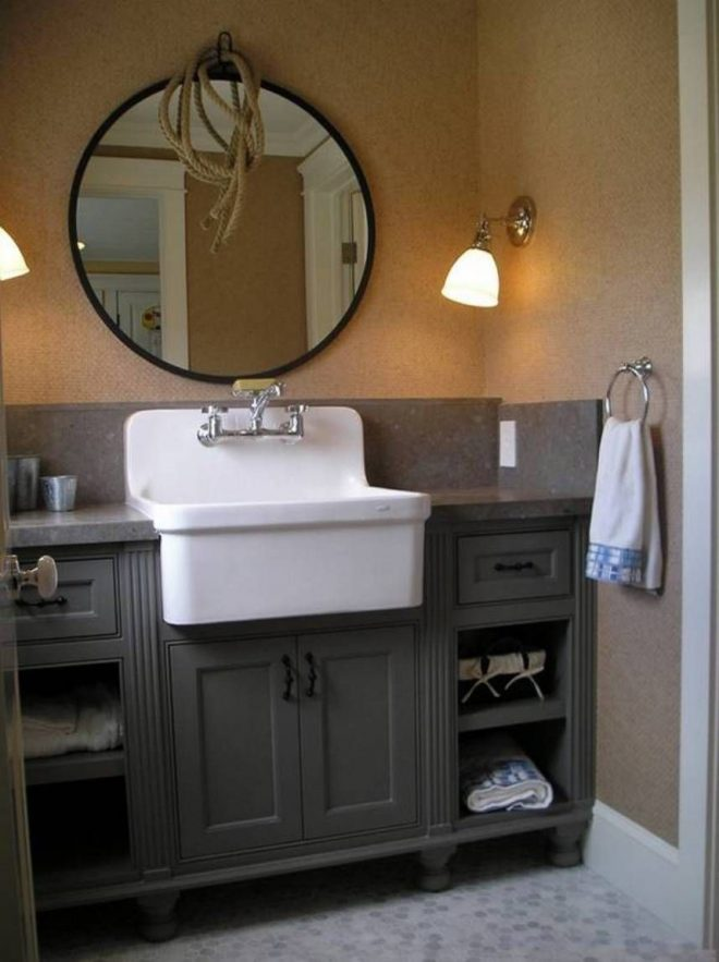 antique bathroom vanity with farmhouse style sink and round