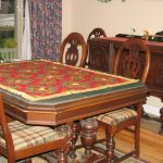 antique dining room set has chairs buffet and a table with