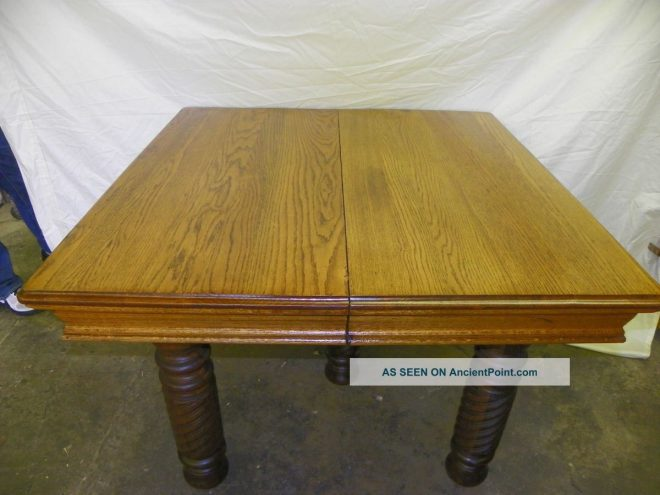 antique square oak dining table with 3 leaves