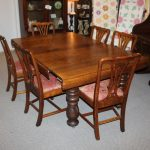 antique square oak five legged dining table with self storing leaves