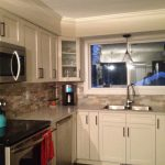 antique white kitchen with brushed bronze pulls and handles