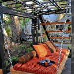 asian outdoor daybed with orange color cover as comfortable