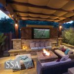 backyard fire pit lounge with outdoor tv designed ssa