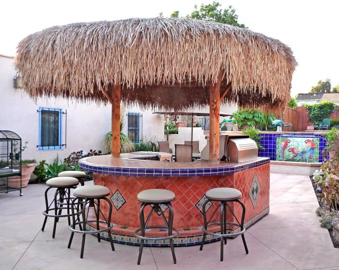 backyard palapa style island barbeque using mexican tiles