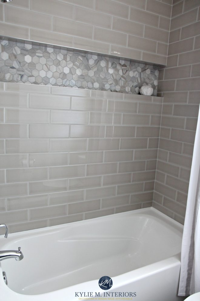 bathroom with bathtub and gray subway tile shower surround