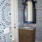 bathroom with moroccan mirror featured blue frames bold