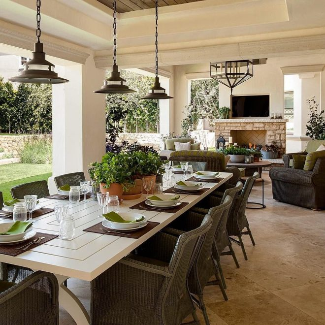 beautiful outdoor covered porch with large table for entertaining