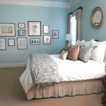 beautiful pale blue master bedroom with gallery wall serene rooms