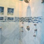 beautiful walk in shower with gray ceramic tile with aqua and