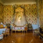 bedroom of the 18th century in a castle in france stock photo