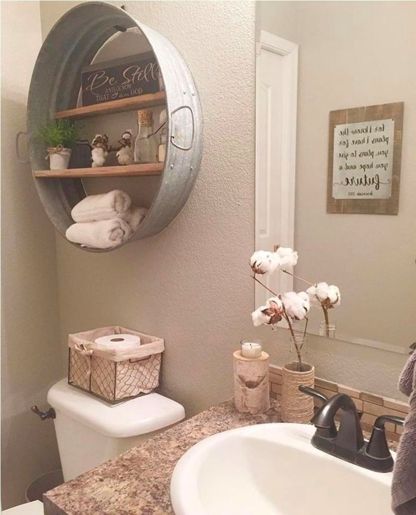 beige wall color with antique wall decor for elegant old bathroom