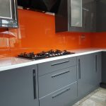 bespoke glass splashbacks fitted to a home kitchen painted