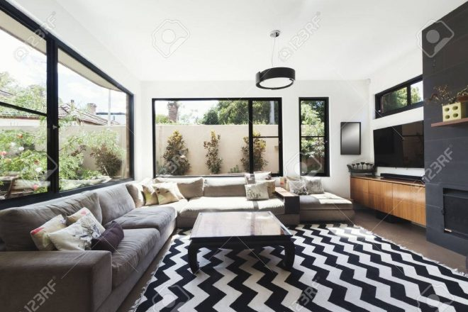 black and white scheme living room with wood and grey tiling