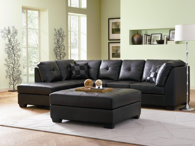 black bonded leather sectional with 2 pillows in porland oregon