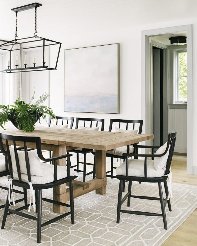 black dining chairs paired with a reclaimed wood dining
