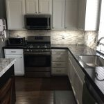 black granite with a gray stone backsplash for the home in 2019