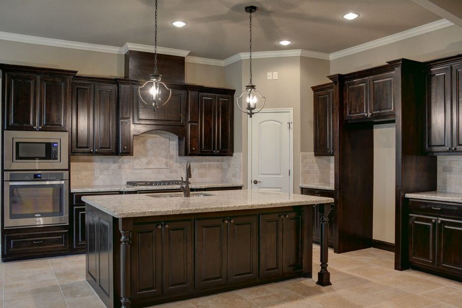 black walnut stained knotty alder cabinets dark kitchen