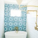 blue white bathroom tile brass fixtures leanne ford