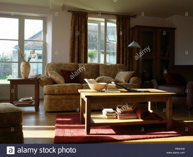 books on simple wood two tier table in country living room