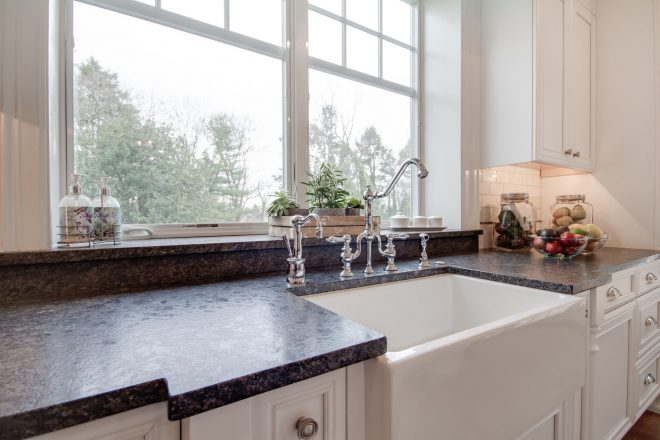 bright white kitchen with silver pearl leathered granite countertops