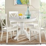 brynwood white 5 pc round dining set with white chairs in