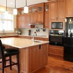 cherry kitchen cabinets in modern transitional kitchen with