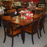 christy dining table shown in grey elm and brown maple with a two tone michaels cherry and onyx finish includes 1 18 leaf