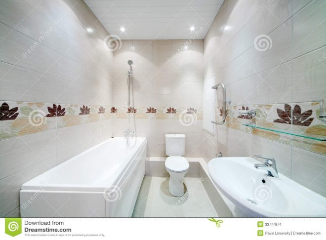clean bathroom with toilet with simple grey tiles stock photo