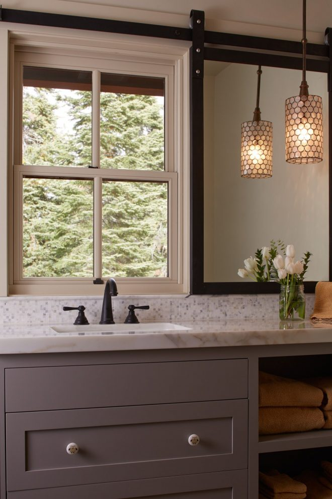 clever mirror solution for window over vanity sliding track
