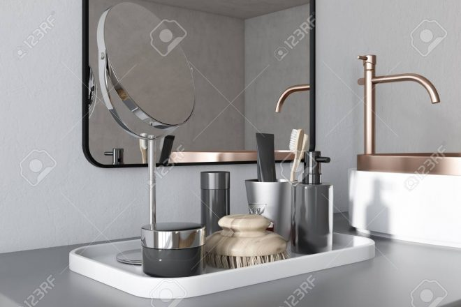 close up of a round white and brass sink in a luxury bathroom