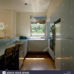 cloud patterned blind on window in a nineties galley kitchen with