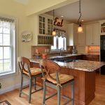 combine small kitchen and sun room to create a spacious