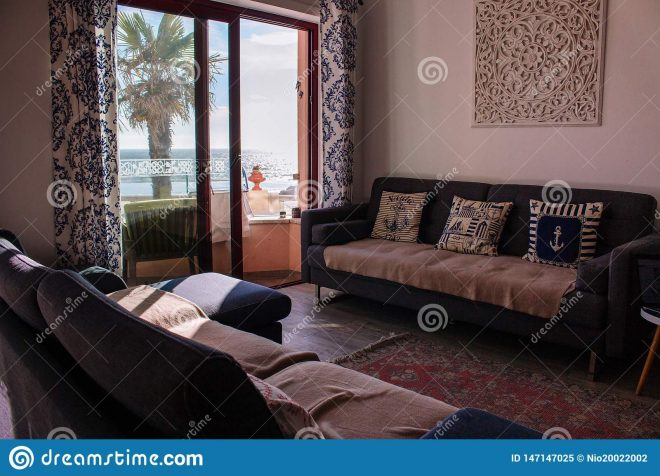comfortable room with sofa and balcony with sea view cozy