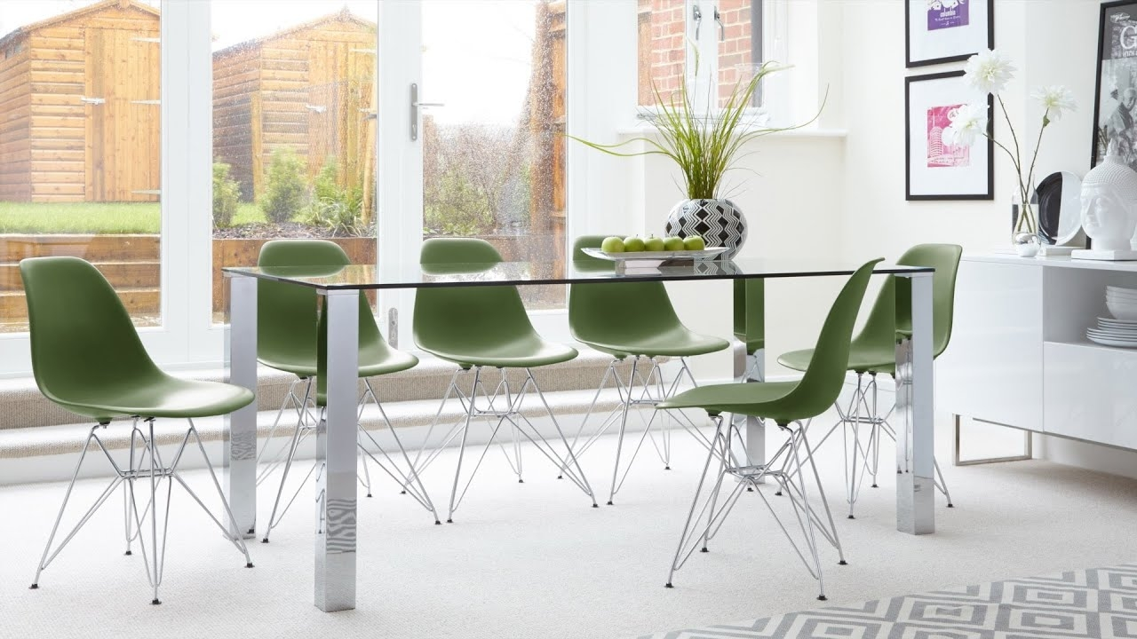 contemporary glass 6 seater dining table and eames dining chairs