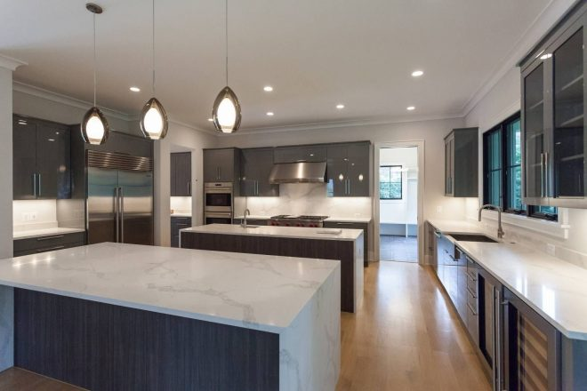 contemporary kitchen with high gloss cabinets and double